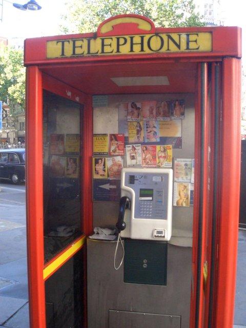 Phone_box_prostitute_calling_cards_1